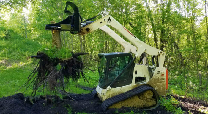 Tree Puller attachment doing some clearing on land