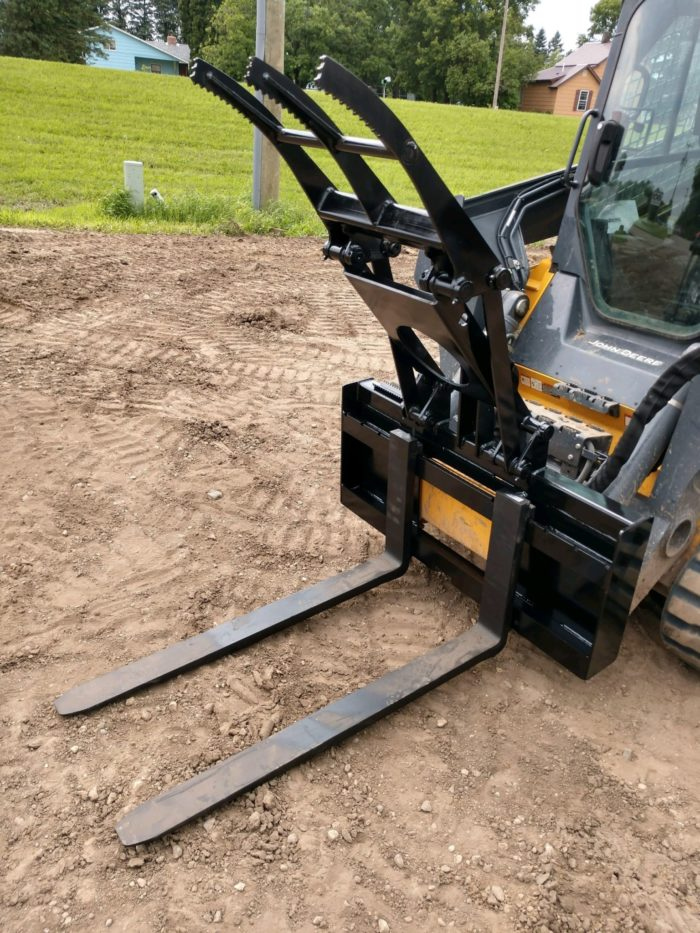 The pallet fork grapple getting ready for a landscaping job